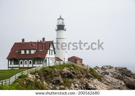 The famous Portland Head lighthouse in heavy fog - stock photo