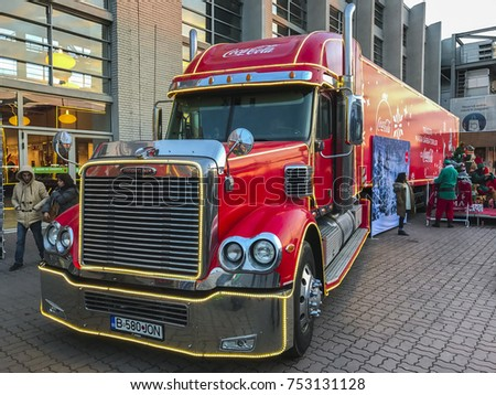 The famous red truck from Coca Cola Company, parked in the front of Electroputere Park Mall on December 21, 2016 in Craiova city, Romania.