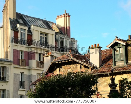 The famous roofs of Montmartre in a clear sunny autumn day. Paris, France.