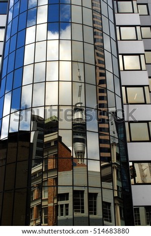 The famous Sky Tower is reflected in a modern office building in Auckland, New Zealand