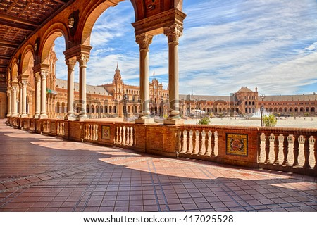 The famous Square of Spain, in Spanish Plaza de Espana, view from the path with columns, one example of the mixing Regionalism Architecture Renaissance and Moorish styles. Seville, Andalucia, Spain. - stock photo