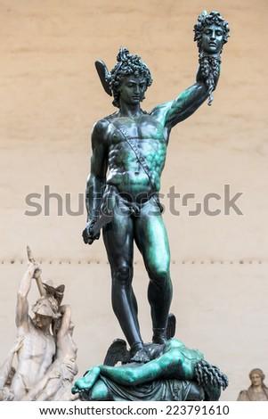 """The famous statue of Benvenuto Cellini """"Perseus with the head of Medusa"""" in Piazza della Signoria in Florence, Italy - stock photo"""
