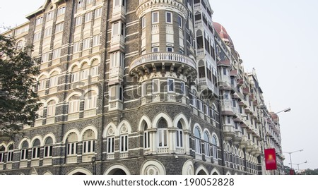 The famous Taj Mahal Hotel of Bombay is situated opposite of the Gateway of India. - stock photo