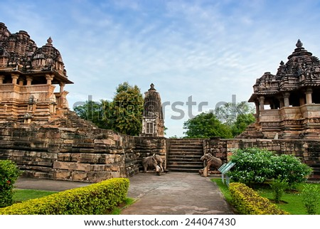 The famous temples of Khajuraho are a large group of medieval hindu and jain temples, famous for their erotic sculptures. Situated in Khajuraho, Madhya Pradesh, India. Unesco world heritage site.  - stock photo