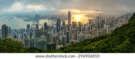 The famous view of Hong Kong from Victoria Peak. Taken at sunrise while the sun climbs over Kowloon Bay. The density of high-rise buildings is obvious in this shot.