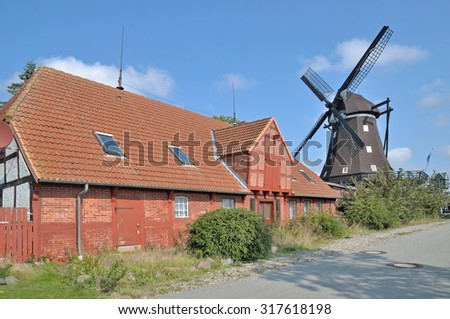 the famous Windmill of Lemkenhafen,Fehmarn Island,Baltic Sea,Germany - stock photo
