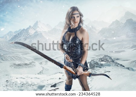 The fantasy hunter girl with bow and arrow - stock photo