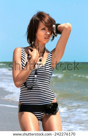 the fashionable girl against the water - stock photo