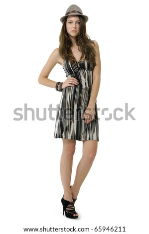 The fashionable young woman in sunglasses standing - stock photo