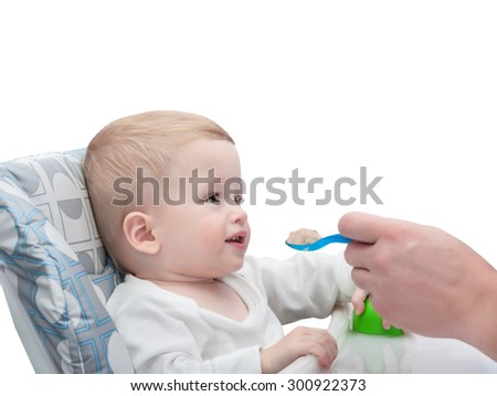 The father feeds with porridge of the one-year-old kid,  isolated on white background