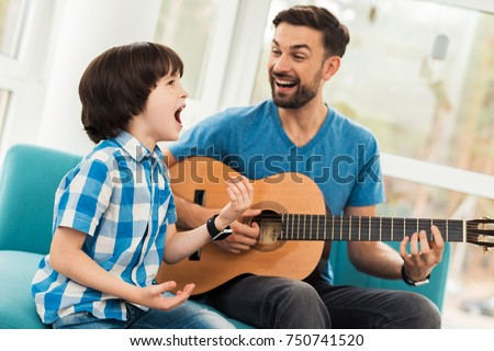 Father Teaches His Son Play Guitar Stock Photo 750741520 - Shutterstock