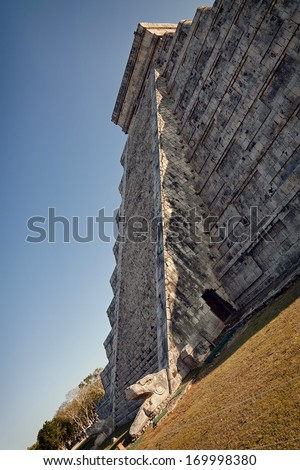 The feathered serpent god of the Mayans, crawls down the pyramid El Castillo during spring equinox. - stock photo