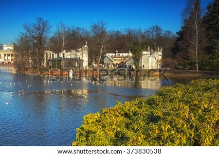 The February morning, view of the pond, the theater on the water and part of the Palace on the Water in Lazienki Royal Park in Warsaw in february. Horizontal view. - stock photo