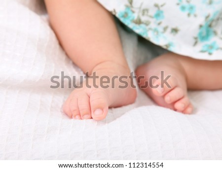 the feet of a baby on a pink blanket
