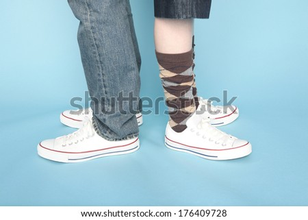 The feet of a Japanese couple back-to-back