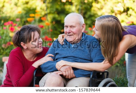 The female generation visiting old grandfather at the nursing home. - stock photo