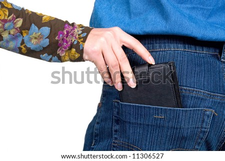 The female hand pulls out a purse from a pocket of the man. - stock photo