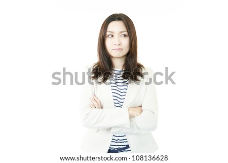 The female office worker who expresses dissatisfaction calmly with folded arms - stock photo