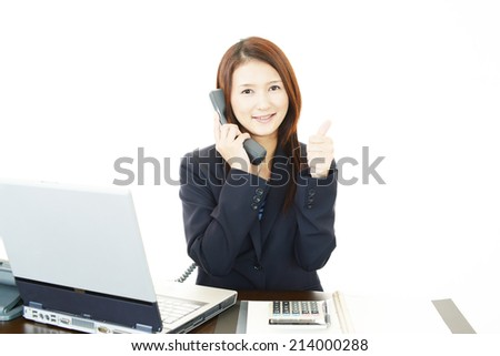 The female office worker who poses happily - stock photo