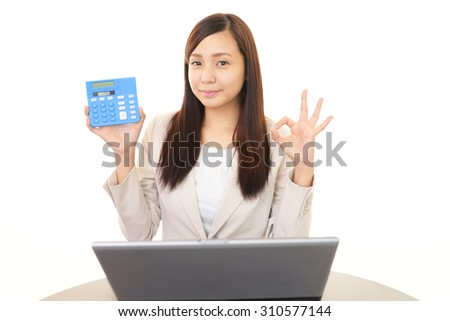The female office worker who poses happy - stock photo