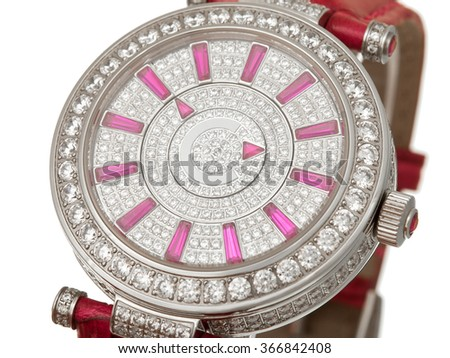 The female watch the dial close up covered with jewels and decorated with diamonds with a red leather thong, on a white background. - stock photo