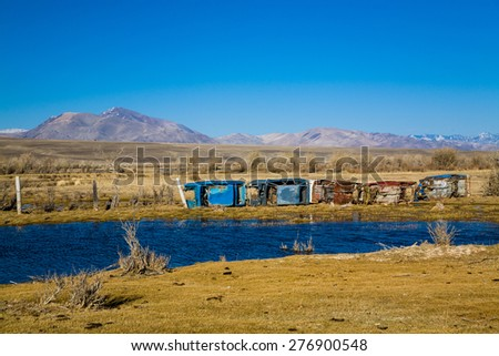 The fence of broken old cars. Russia. Altai. - stock photo