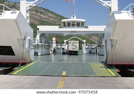The ferry at the port with empty deck - stock photo