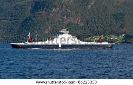The ferry in norwegian fjord - stock photo