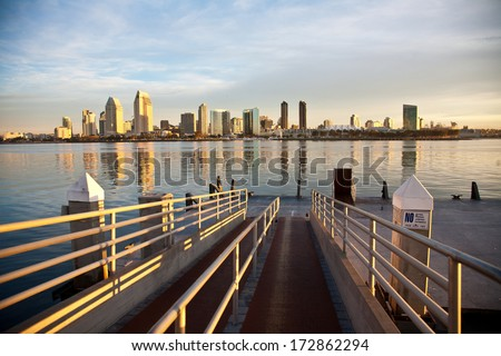 The ferry pier in Coronado with the city of San Diego in the background. - stock photo