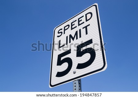 The fifty-five miles per hour street sign in the California sun.