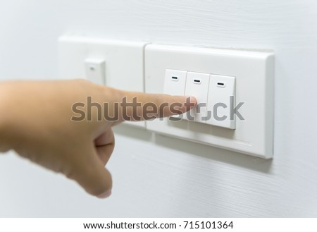 The finger is pressing the power switch off. To save energy