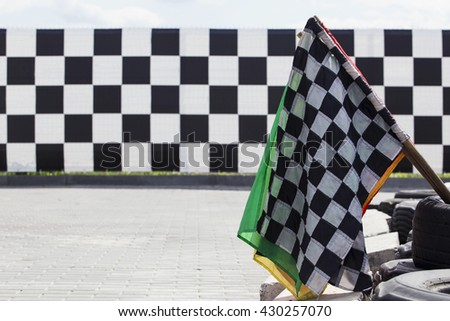 the finish flag at a sports track - stock photo
