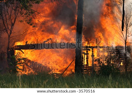 The fire ends as the shell of the garage remains - stock photo