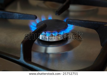 the fire of gas on the kitchen furnace - stock photo