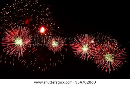 the fireworks ,  a device containing gunpowder and other combustible chemicals that causes a spectacular explosion when ignited, the fireworks
