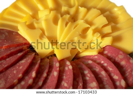 The firm cheese sliced and blood sausage with fat