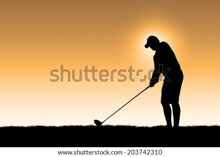 The first drive of the day - Isolated image of a golfer with and orange background and a halo around his head - stock photo