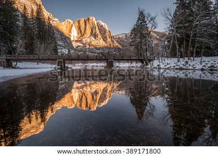 The first light on the Yosemite Fall in winter at Swinging Bridge. - stock photo