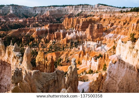 The first rays of the sun rush in Bryce Canyon, Utah, USA