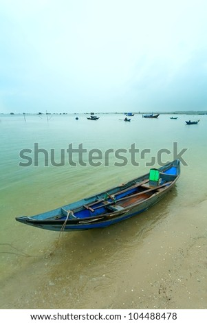 the fishing boat with oars on the lake - stock photo