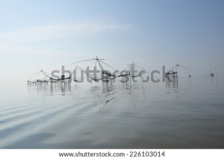 the fishing trap in the lake - stock photo