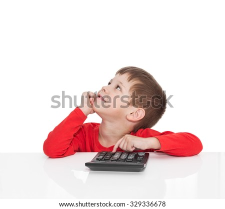 The five-year boy sitting at a white table and presses the button calculator, dreams isolated on white - stock photo