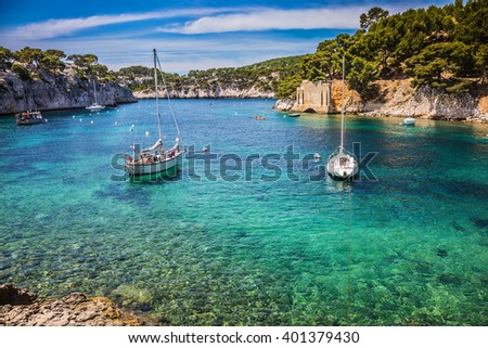 The fjords between stony coast. White sailing yachts wait for the owners.  National Park Calanques on the Mediterranean coast - stock photo