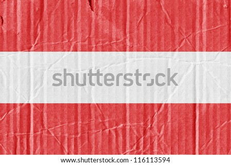 The flag of Austria painted on a cardboard box