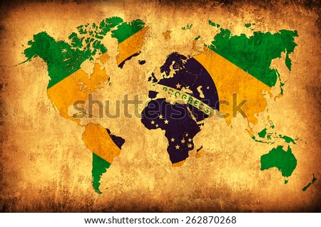The flag of Brazil in the outline of the world map - stock photo
