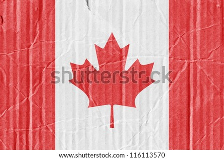 The flag of Canada painted on a cardboard box - stock photo