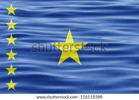 The flag of Democratic Republic of Congo on water