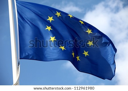 The flag of Europe waving in the wind - stock photo