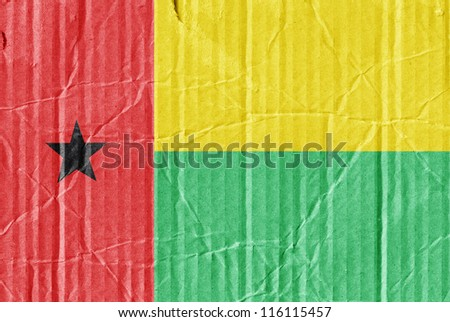 The flag of Guinea Bissau painted on a cardboard box