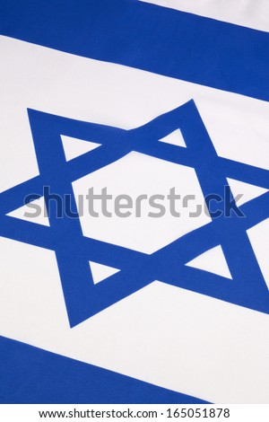 The flag of Israel was adopted on October 28, 1948, five months after the country's establishment. - stock photo